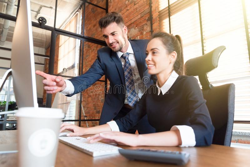 Team business couple co-working in office. Team business couple working in office. Cooperation and co-working concept royalty free stock image