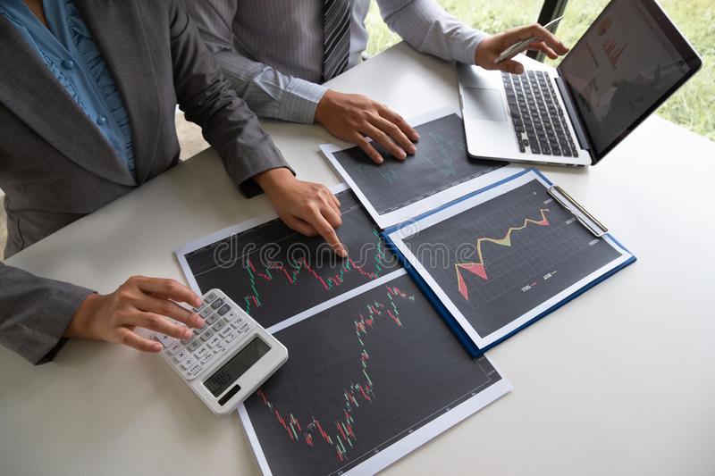 A team of business executives are planning consultations about business investments related to shares. By analyzing and calculating the stock market to find royalty free stock photos