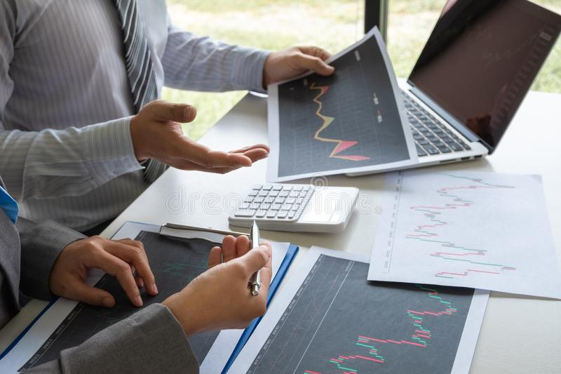 A team of business executives are planning consultations about business investments related to shares. By analyzing and calculating the stock market to find stock photography
