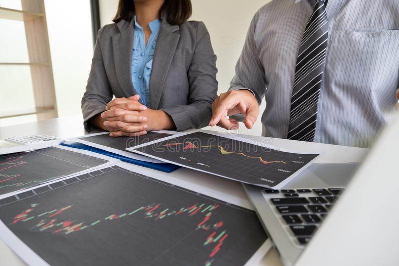 A team of business executives are planning consultations about business investments related to shares. By analyzing and calculating the stock market to find stock photo