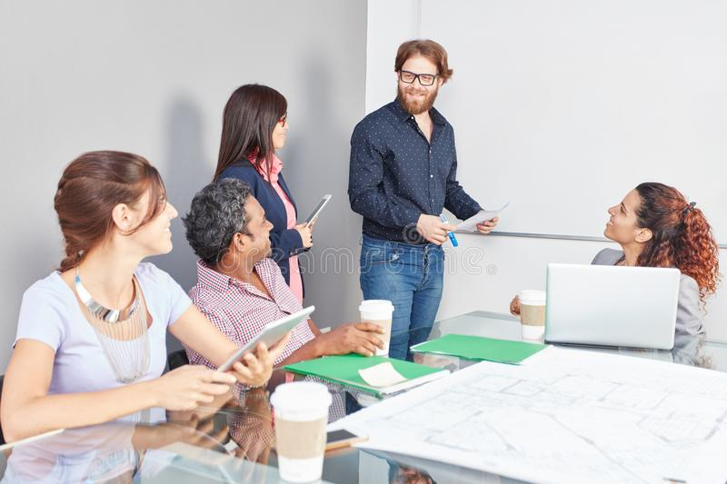 Team in business meeting presentation royalty free stock photography