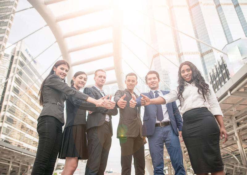 Team Business Partners Giving Thumb up Bump after Complete a deal. Successful Teamwork Partnership. In an office. Businessman with hands together. business stock photos