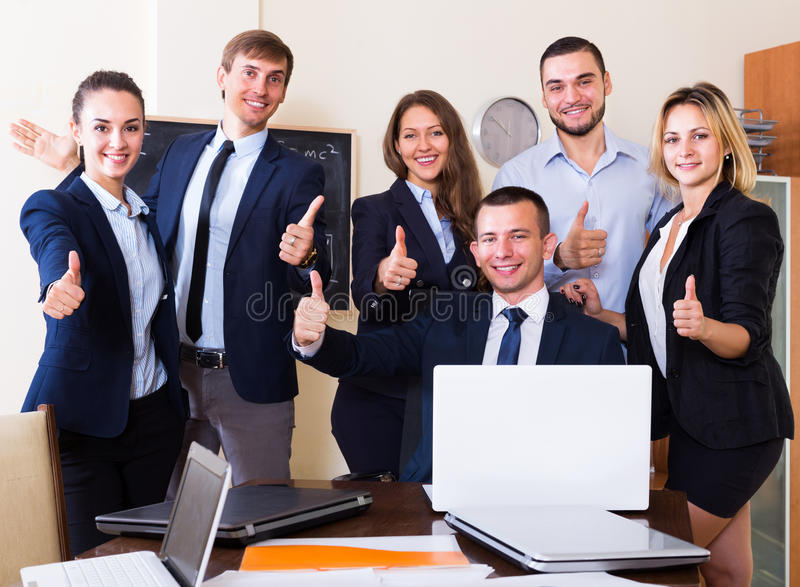 Team of business partners professional posing stock photos