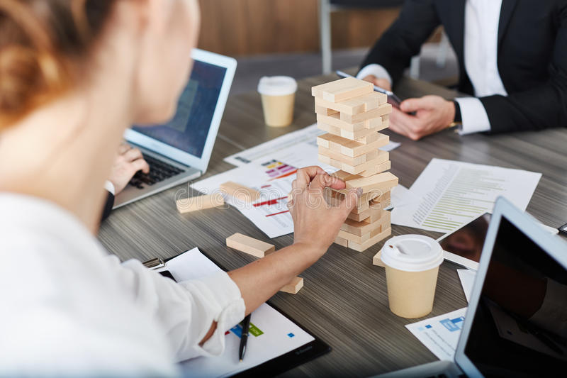Team of business people build a wooden construction. concept of teamwork and partnership stock photo