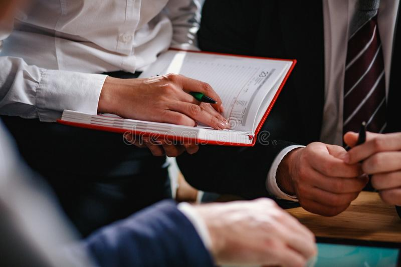 A team of business people discusses financing stock image
