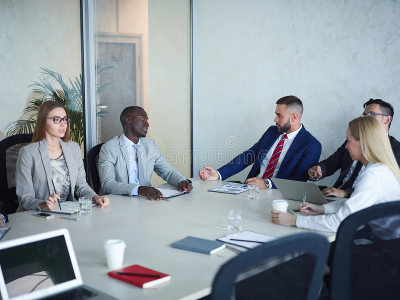Team of Business People Meeting in Conference room stock photo