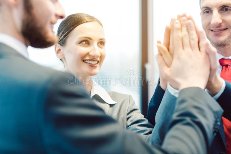 Team of business people sticking and working together royalty free stock images