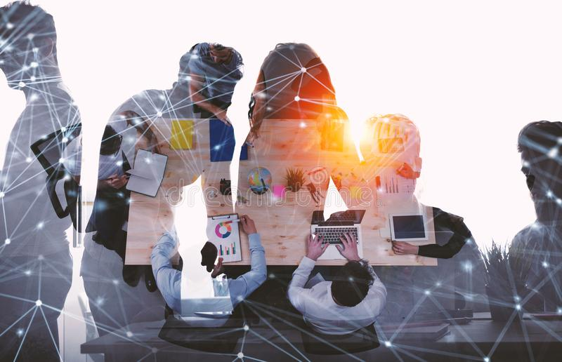 Team of businessmen work together in office. Concept of teamwork and partnership with network effect. double exposure royalty free stock photos