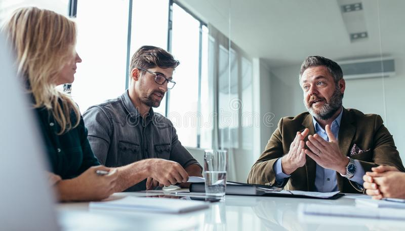 Team of business professionals having a meeting stock photos