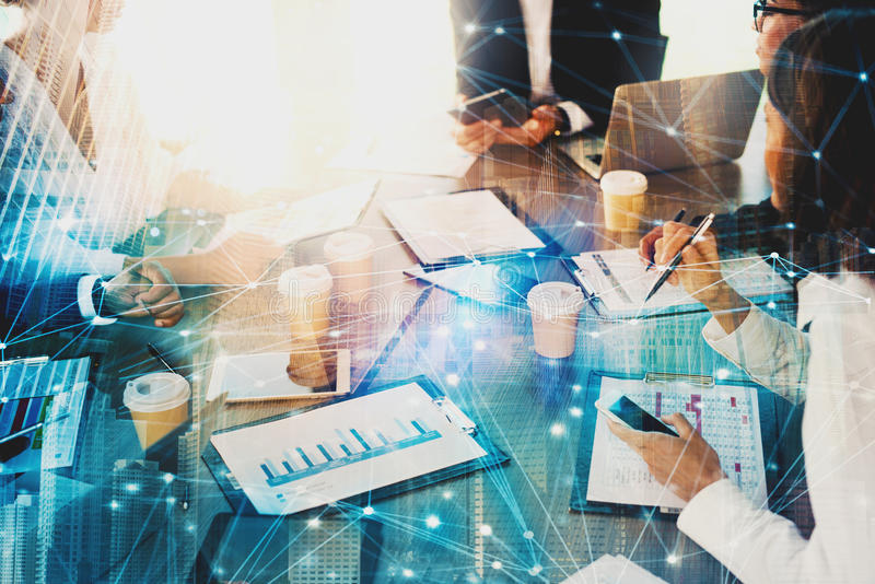 Team of businessmen work together in office with network effect. Concept of teamwork and partnership. Team of business people work together in office with royalty free stock image
