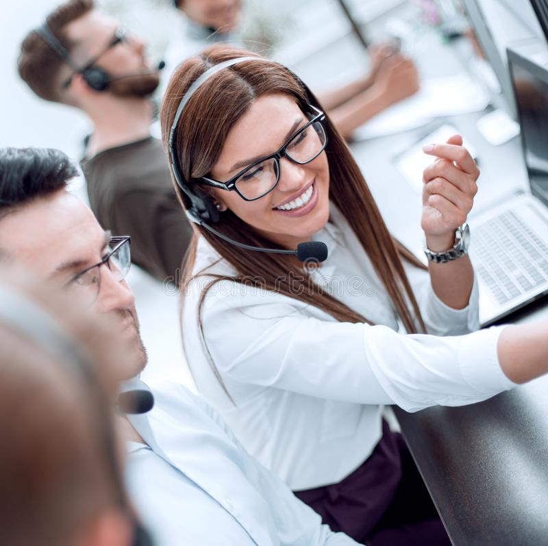 Team of call center operators in the workplace stock images