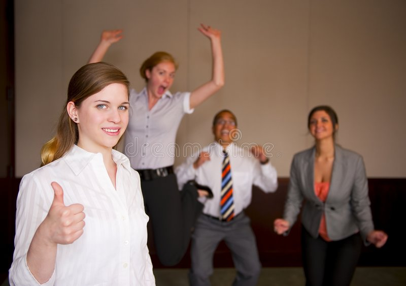 Team Celebration With Woman In Foreground Royalty Free Stock Photography