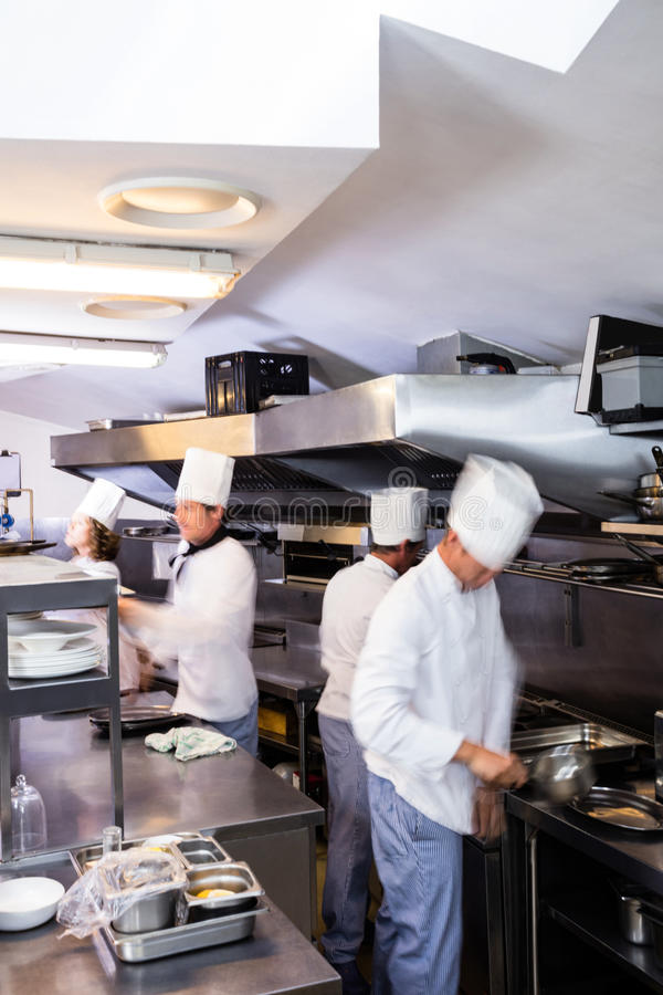 Team of chefs preparing food in the kitchen royalty free stock images