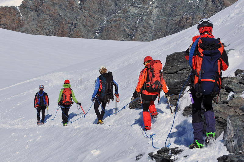 Team of climbers royalty free stock photos