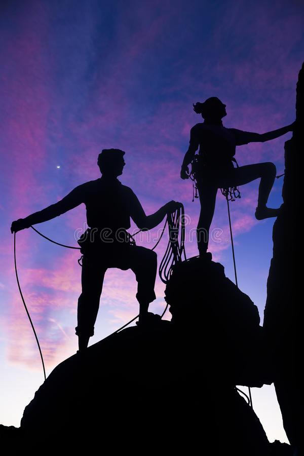 Team of climbers reaching the summit. royalty free stock photo