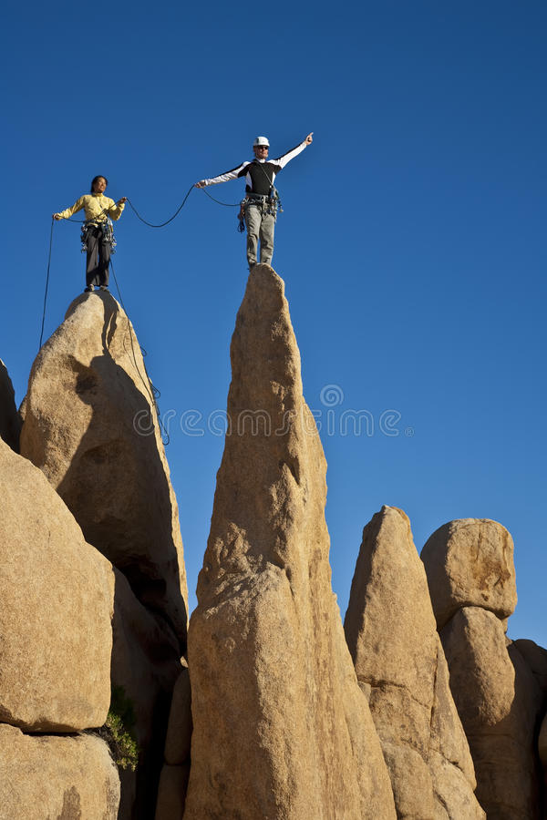 Team of climbers reaching the summit. royalty free stock photos