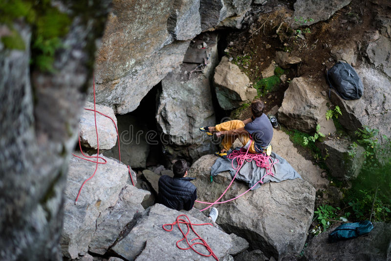 Team of climbers on the rock, pepare to climb. Climbing equipment. royalty free stock photos