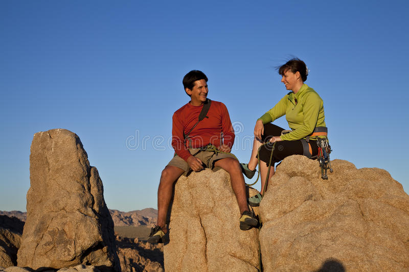 Team of climbers on the summit. stock photography