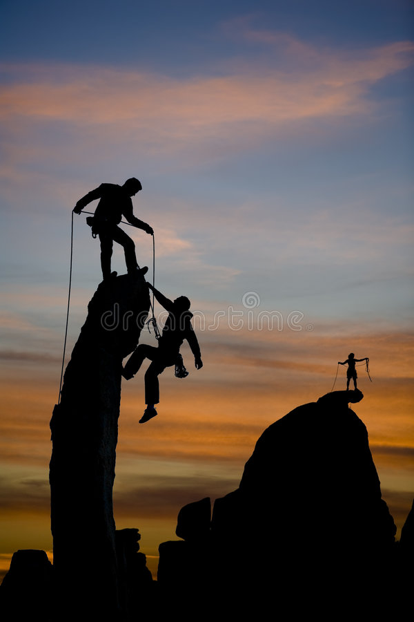 Team of climbers on the summit. royalty free stock image
