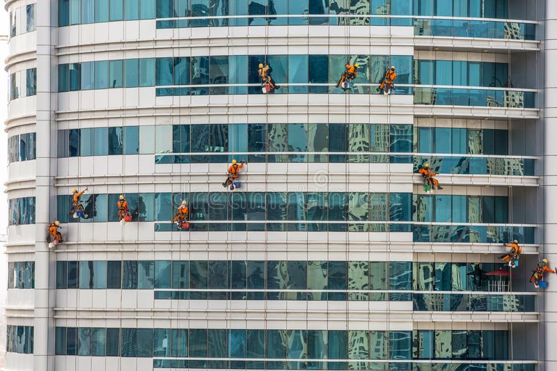 Team Of Climbing Workers Cleaning fotografia stock