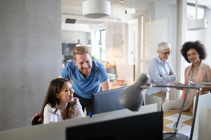 Team of colleagues brainstorming together while working in modern office. Team of colleagues brainstorming together while working in office stock image