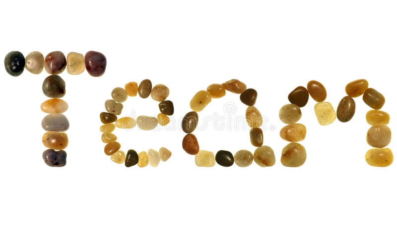 Team In Colored Pebbles Royalty Free Stock Photography
