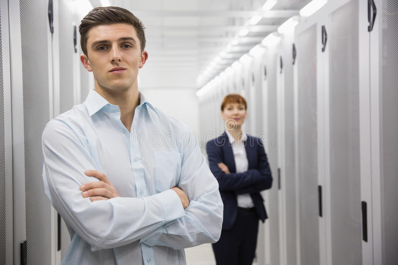 Team of computer technicians looking at camera royalty free stock image