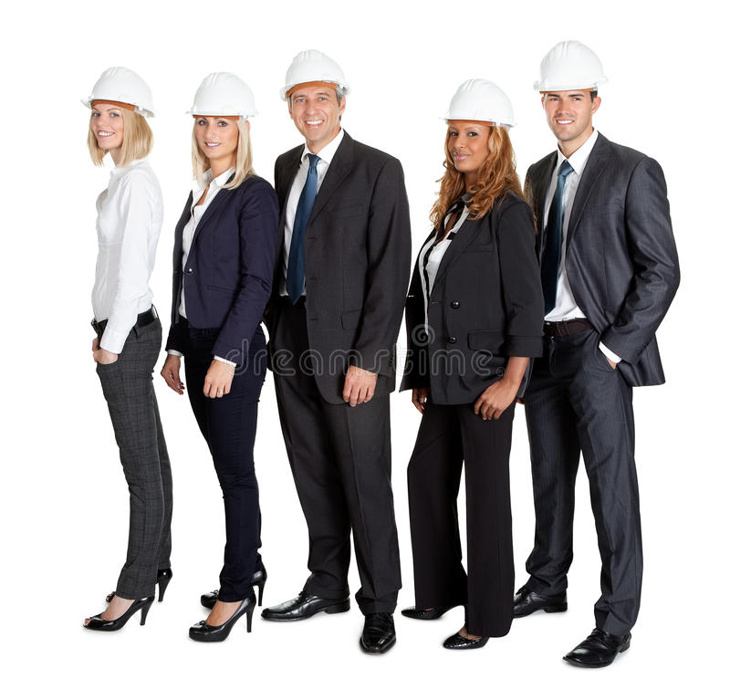 Team of confident civil engineer against white royalty free stock image