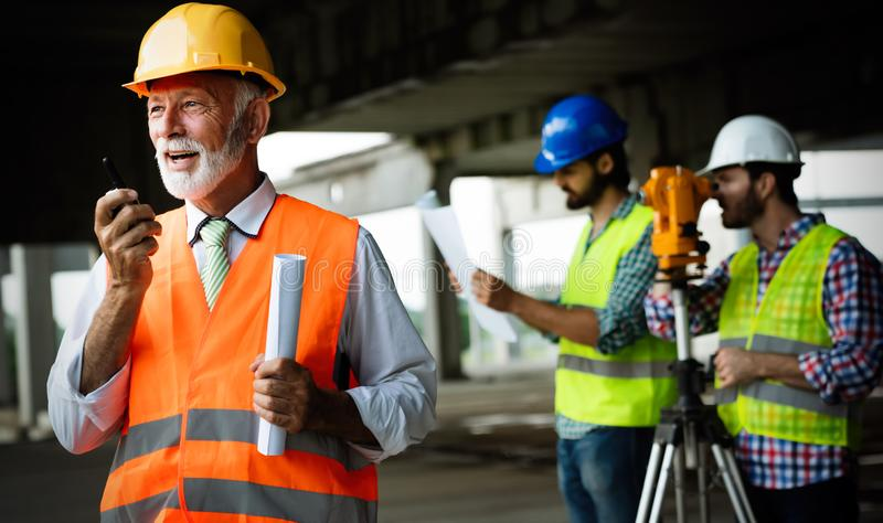 Team of construction engineers, architects working on building site royalty free stock images