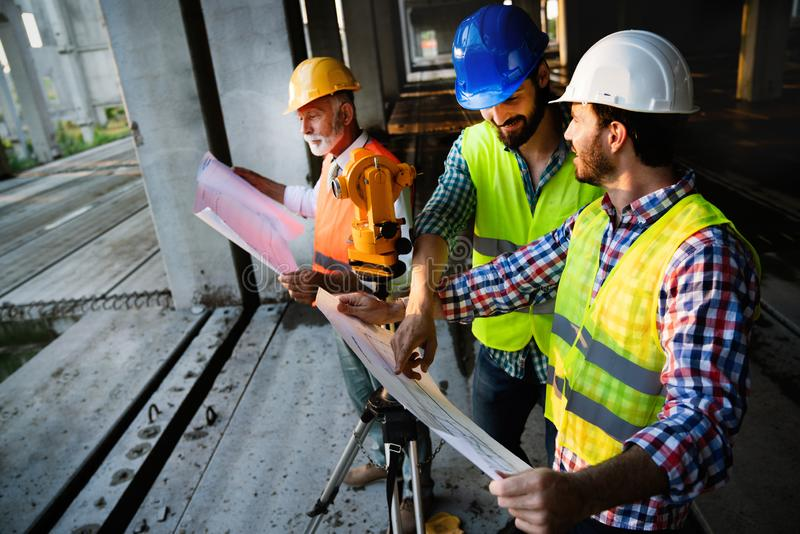 Team of construction engineers, architects working on building site stock photo