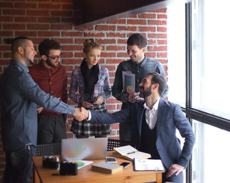 Team of copywriters and a handshake of business partners in a creative office. stock photos