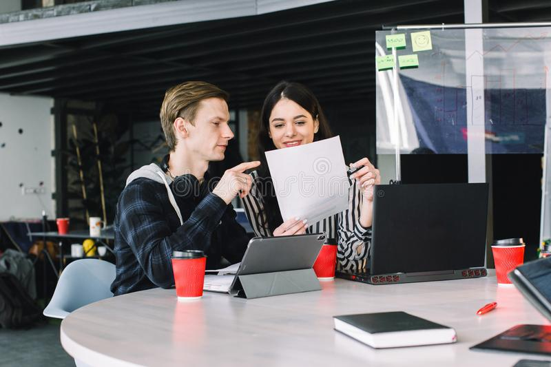 Team of coworkers making great work discussion in modern office. Young business teamwork concept. Young man talking with royalty free stock image
