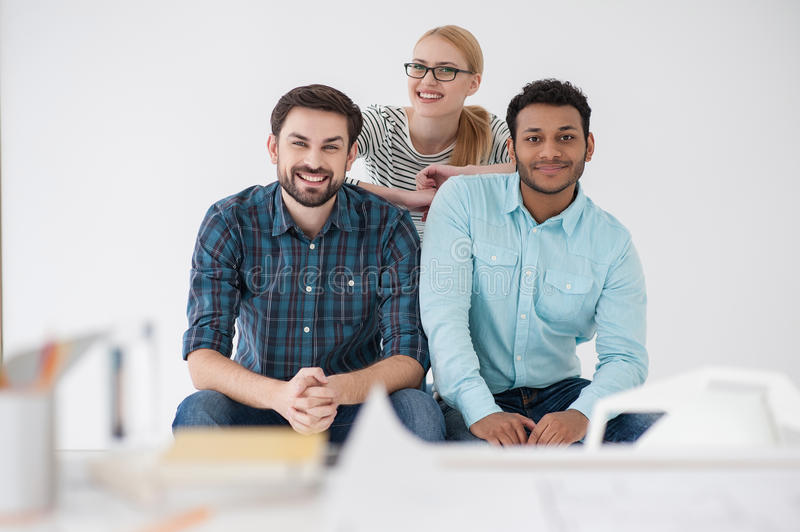 Team of creative colleagues in modern office stock photography