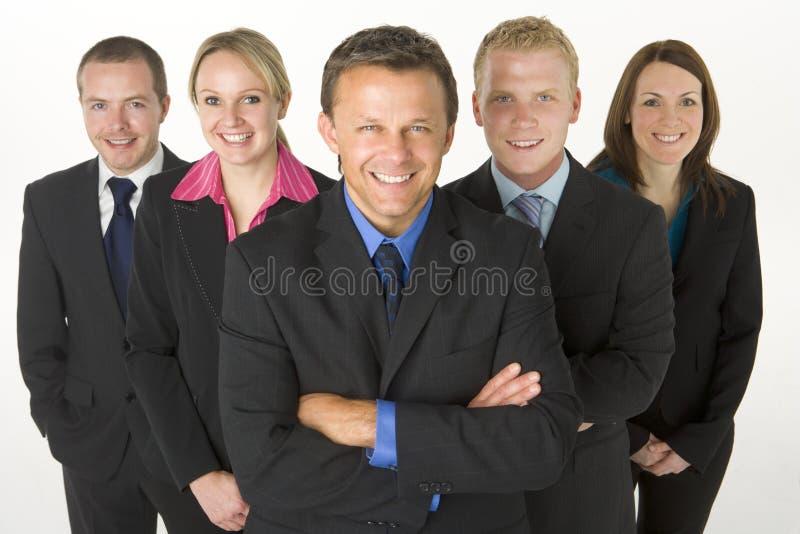 Team der Geschäftsleute Lächelns lizenzfreies stockfoto