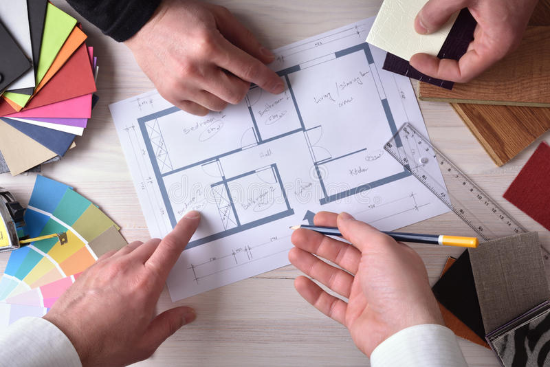 Team of designers developing a decoration project top royalty free stock images