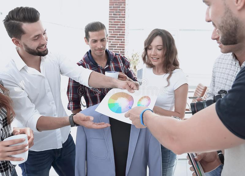 Team of designers discussing the color palette. In the Studio royalty free stock image