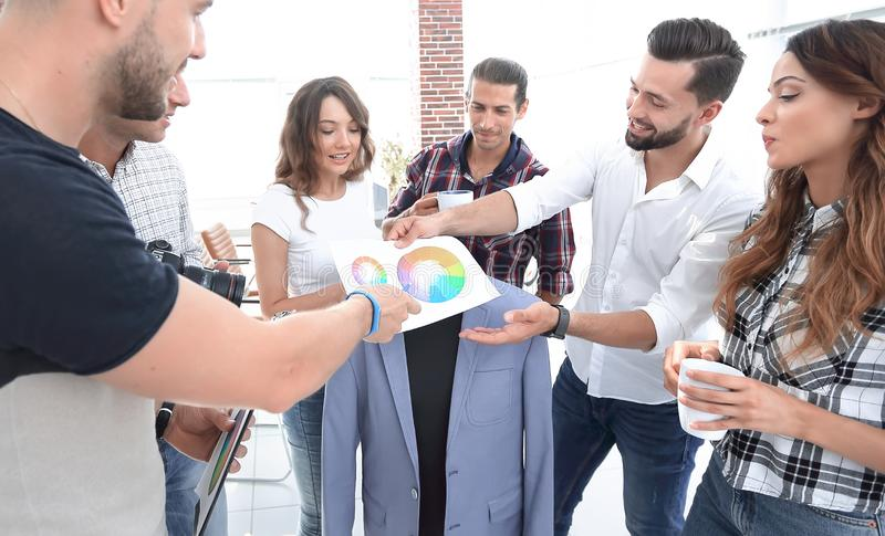 Team of designers discussing the color palette royalty free stock photography