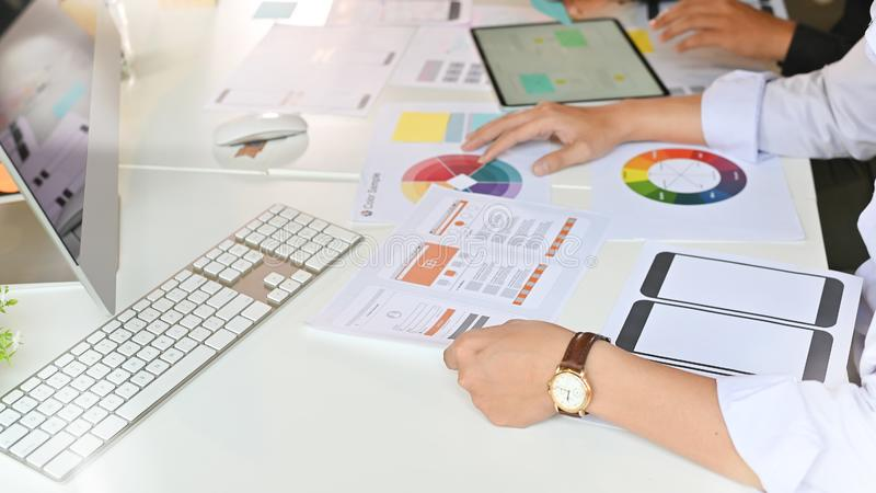 Team developer ux ui designer creative graphic planning application development a prototype smartphone application layout royalty free stock photography
