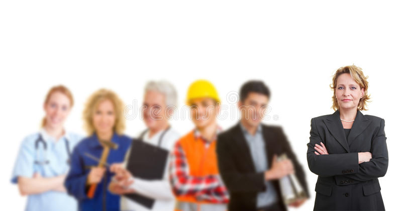 Team with different occupations and trades. Business women standing in front of a team with different occupations and trades stock photography