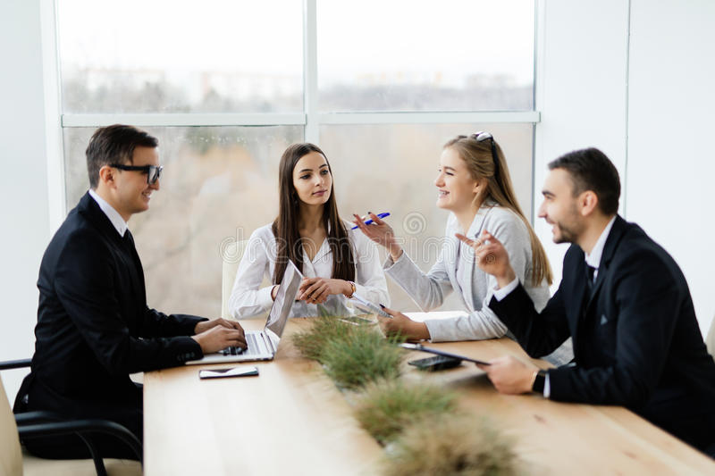 Team discussing at meeting in conference room. royalty free stock image