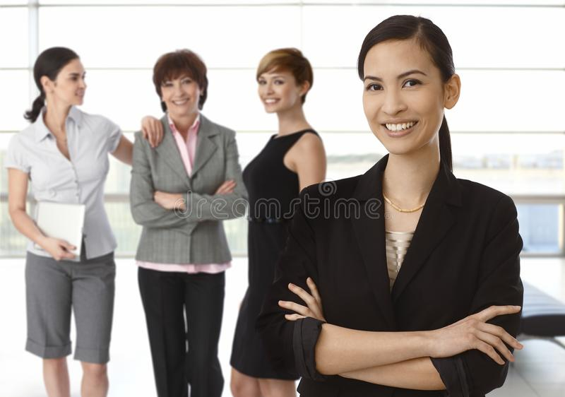 Team of diverse businesswomen. Happy asian women at front stock photos