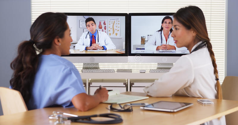 Team of diverse medical doctors having a video conference royalty free stock images