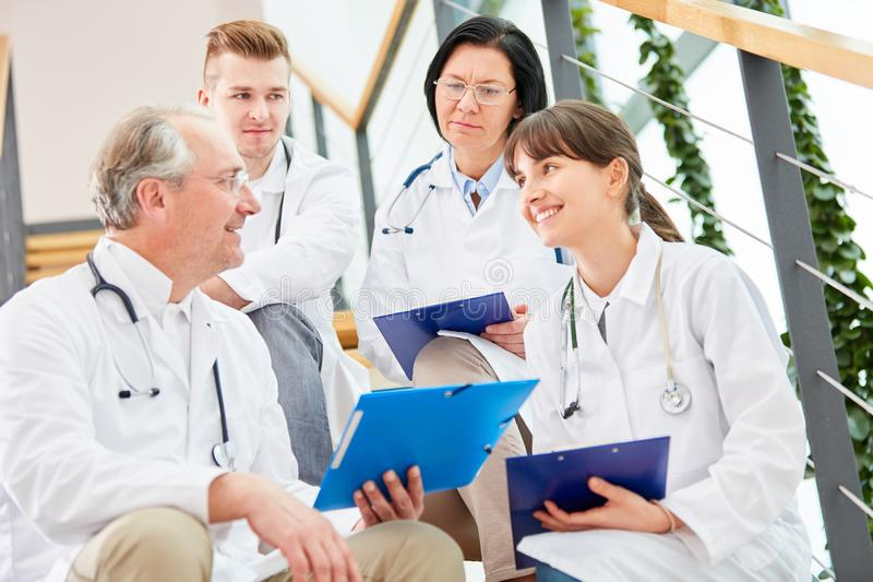 Team of doctors with nurse royalty free stock image