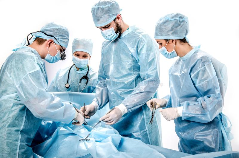 A team of doctors in the operating room. royalty free stock image