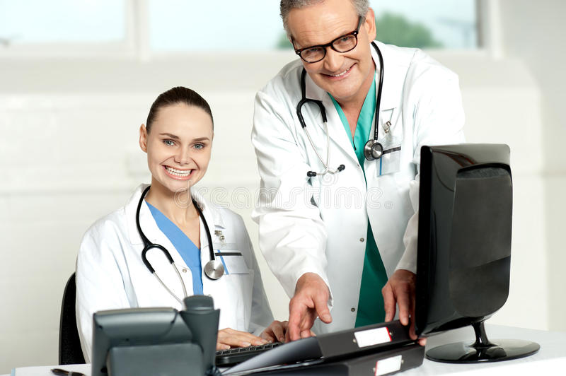 Download Team Of Doctors Working On Computer Stock Photo - Image: 26097504