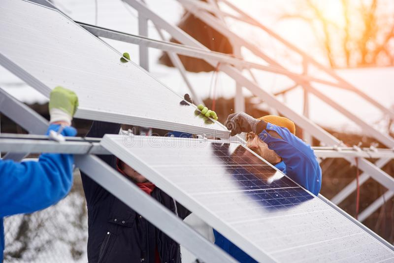 Professional electrician worker installing solar panels. Team of electrician workers installing solar panels on power station photovoltaic energy electricity stock photos