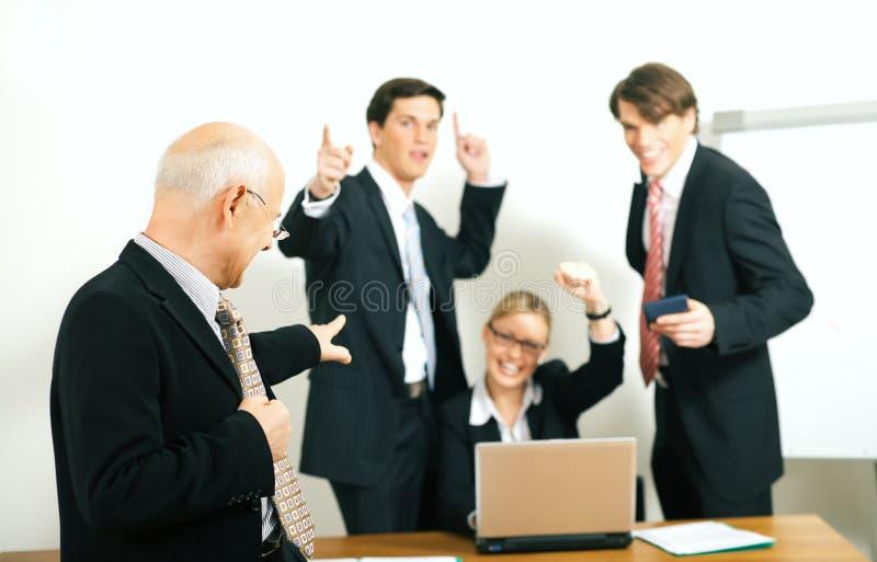 Team en Teamleader: succes stock afbeeldingen