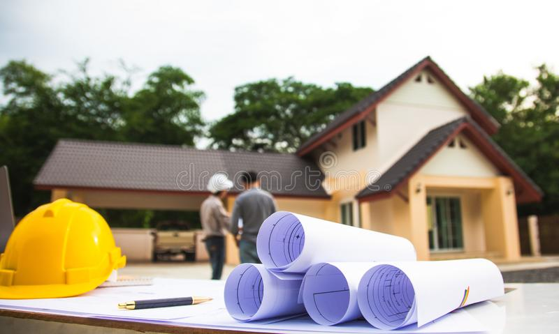 Team Engineer and manager project work.blueprint at Construction Site with new startup in Office stock image