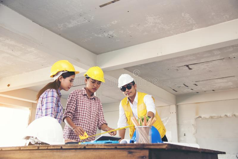 Team engineering work meeting together. Team conference in construction site. Discuss project on site royalty free stock photo