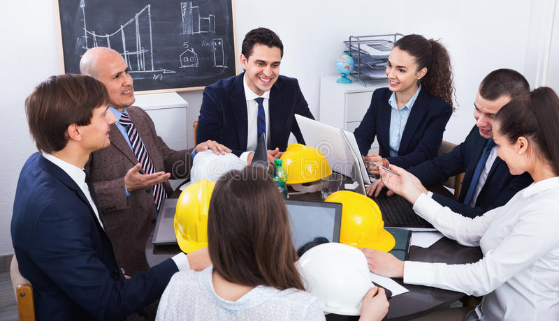 Team of engineers and architects discussing business project royalty free stock image